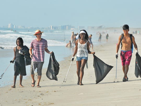 Volunteers cleaning up litter on Tables Beach, across from Patrick Air Force Base, for the Keep Brevard Beautiful /FLORIDA TODAY Summer Series Surf and Turf Saturday, from 8:00-10:00am.