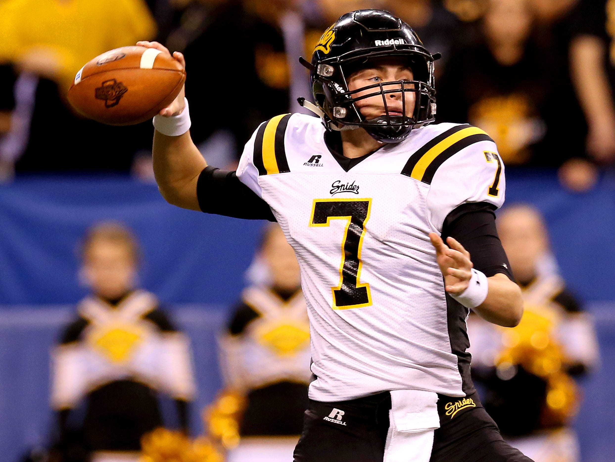 Fort Wayne Snider's Isaac Stiebeling (7) drops back to pass at Lucas Oil Stadium on Nov. 27, 2015.