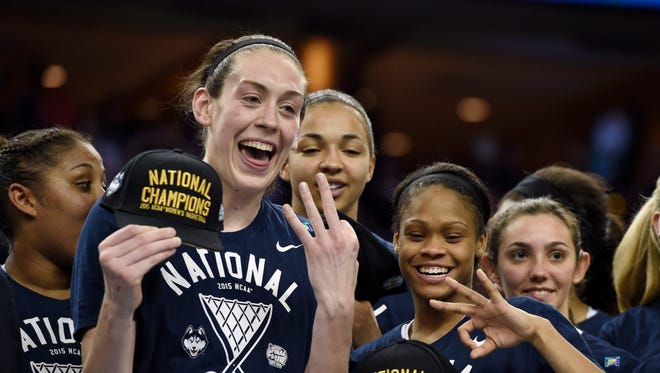 Connecticut Huskies forward Breanna Stewart (left) and guard Moriah Jefferson (right) show three fingers signifying the Huskies third consecutive National Championship after winning the 2015 NCAA Women's Division I Championship game at Amalie Arena. Connecticut defeated Notre Dame 63-53.