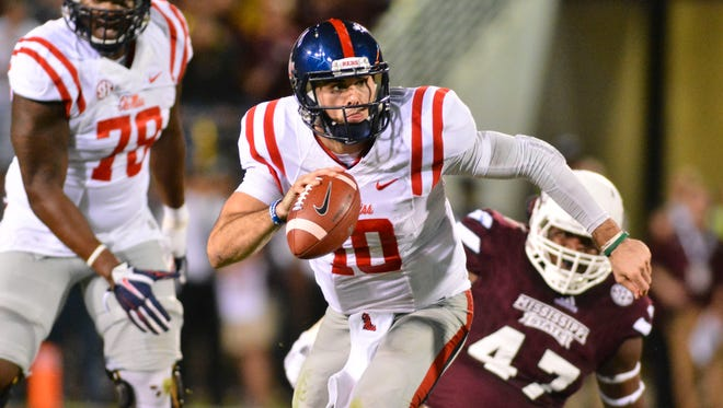 Ole Miss quarterback Chad Kelly has rushed for six touchdowns in his past three games after the Rebels began using more designed runs for him.