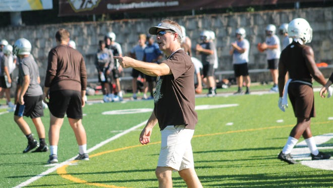Roger Bacon coach Mike Blaut fires off instructions for the Spartans in preseason work.