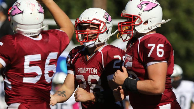 Pompton Lakes tailback Frank Negrini (28) carried 24 times for 145 yards in the Cardinals' 14-12 win over Waldwick/Midland Park on Friday night.