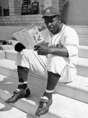 Jackie Robinson,  a member of the Montreal Royals,