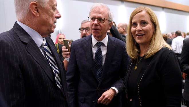 Former mayors Phil Bredesen and Bill Purcell chat with Nashville Mayor Megan Barry at the release of her new transit plan at Music City Center Tuesday, Oct. 17, 2017 in Nashville, Tenn.