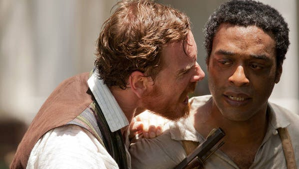 """Chiewetel Ejiofor (right) and Michael Fassbender in """"12 Years a Slave."""""""