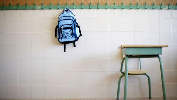 Students mocked another student and went through his belongings because of his national origin.