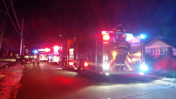 Des Moines firefighters respond to a fatal house fire on 61st Street on Tuesday, Feb. 9.