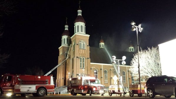 Firefighters putting effort on the north and east (front) sides of the church.