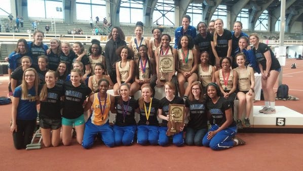 Athletes from first-place Warren Central and second-place Carmel posed together after the Hoosier State Relays.