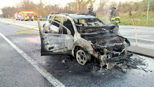 Firefighters put out a vehicle fire on Route 15 on Thursday.