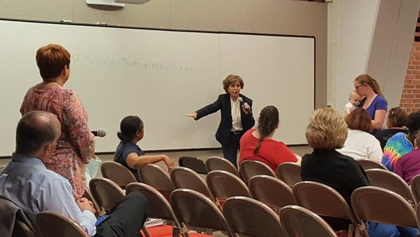 Carolyn Long with Management Advisory Group Inc. going over some numbers at a JCPS forum on the salary study.