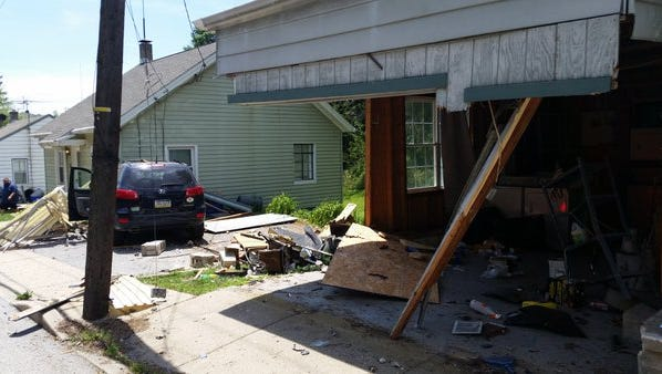 The vehicle went through one structure before crashing into a residence.