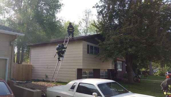 Poudre Fire Authority crews work a fire on North Roosevelt on May 23.