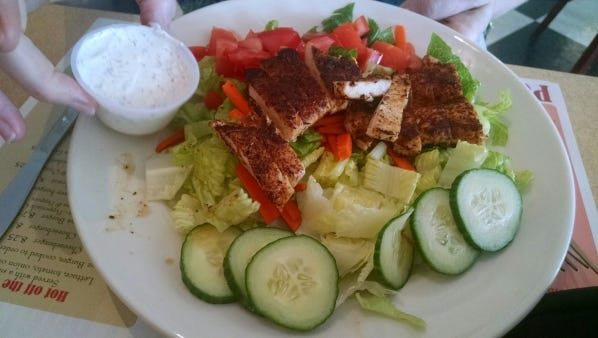 Poinciana Café's  large house salad  with zesty blackened chicken and homemade ranch dressing.