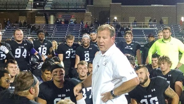 Jed Stugart talks to his USF players following their win over Minnesota Duluth in 2015