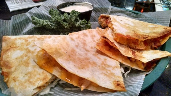 Tin Fish's blackened Mahi quesadilla is flaky seasoned filet  in a flour tortilla stuffed with pico de gallo and melted cheddar cheese.