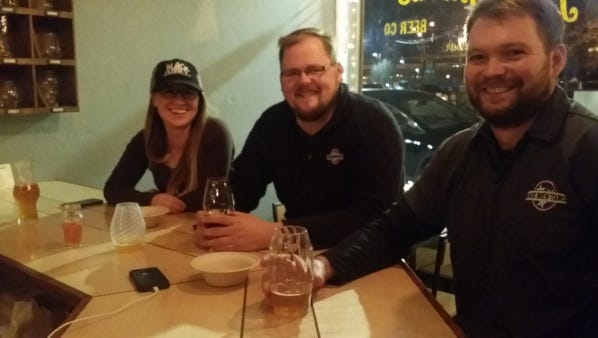 Christinea Beane, Zack Roskop and Everett Hirche, from left, have a night out at Pretentious Beer & Glass.