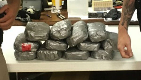 Police seized several packs of cocaine, worth a total of more than $1.3 million, in Duson Sunday