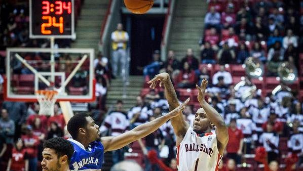 Ball State's Zavier Turner shoots over Indiana State's defense Saturday during the Cardinals' 70-63 win at Worthen Arena.