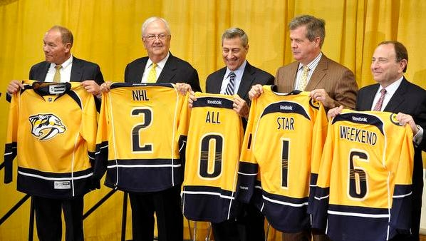 NHL Commissioner Gary Bettman, right, stands with, right to left, Nashville Mayor Karl Dean, Nashville, Bridgestone Americas CEO and President Gary Garfield, Predators Chairman/Governor Tom Cigarran and Nashville Predators/Bridgestone Arena CEO Jeff Cogen as they all hold jerseys in a photo op announcing that Bridgestone Arena will be the site of the 2016 All-Star Game.