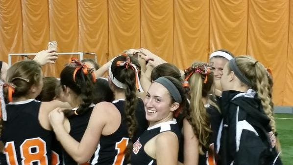 Mamaroneck players huddle together following their 4-0 victory over Kingston to advance in the Class A field hockey state tournament.