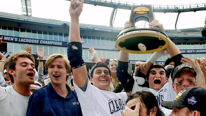 Yale players celebrate after beating Duke to win the NCAA lacrosse title at Gillette Stadium.