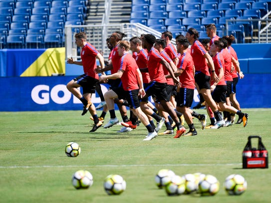 The US soccer team practices for Saturday's  game against