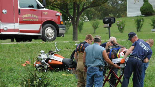 Rescuers prepare a motorcycle occupant to be transported by emergency squad Monday from the scene of a motorcycle crash involving a pickup truck in the 1600 block of Oak Lane, Kingston – part of a busy midday period for area law enforcement and emergency crews.