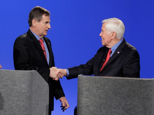 U.S. Senate candidates running in the GOP primary, Sen. Richard Lugar, R-Ind. and Richard Mourdock, left, participate in a debate Wednesday, April 11, 2012, in Indianapolis.