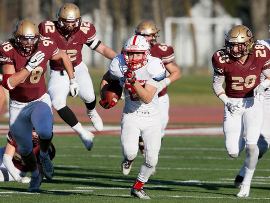 Dusty Krueger of St. John's out-runs the pack on an