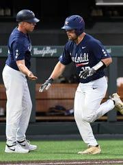 Vanderbilt's Stephen Scott (19) is congratulated by coach Tim Corbin after hitting a home run in the third inning Sunday.