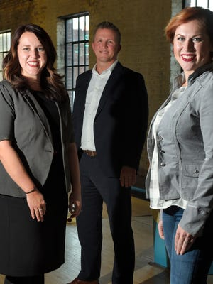 Courtney Jones, Clint St. Mosley and Andrea Dake work for MomSource, a company that helps professionals find a job that meets their schedules in a chosen field.