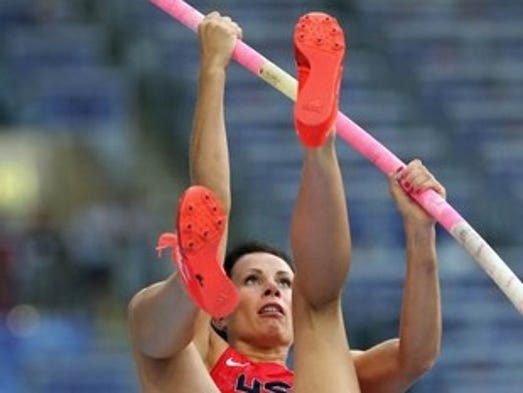 Jenn Suhr of the United States competes in the women's pole vault final.