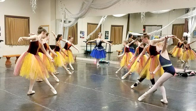 """Performers practice their waltz from """"Twisted Tales."""""""