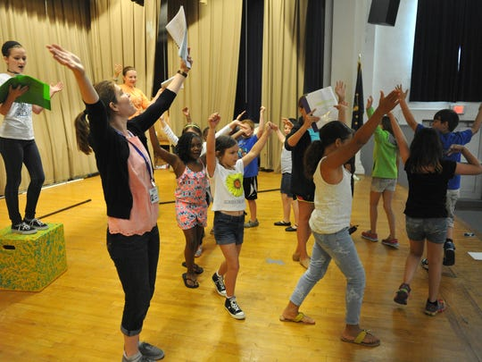 """Missoula Children's Theatre actor and dirctor Courtney Wood (front left) leads a group of local students who auditioned to perform in the theatre's production of """"The Little Mermaid"""" during a rehearsal at Washington Middle School in Evansville last year. A cast of up to 60 students in kindergarten through eighth grade are taking part in the week-long learning event so they can gain more experience with musical theater."""