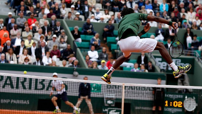 Gael Monfils of France fires a leaping forehand during his victory Friday against Pablo Cuevas of Uruguay.