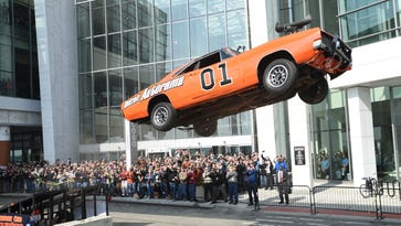 """Rayond Kohn of the Northeast Ohio Dukes drives a General Lee replica form the """"Dukes of Hazzard""""  show to open the 2017 Autorama behind Cobo Center."""