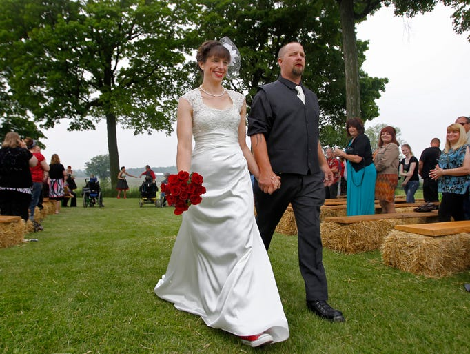 The new husband and wife David and Sarah Forster during a country wedding held at Mulberry Lane Farm on June 20, 2014 in Hilbert, Wis. Wm.Glasheen/Post-Crescent Media