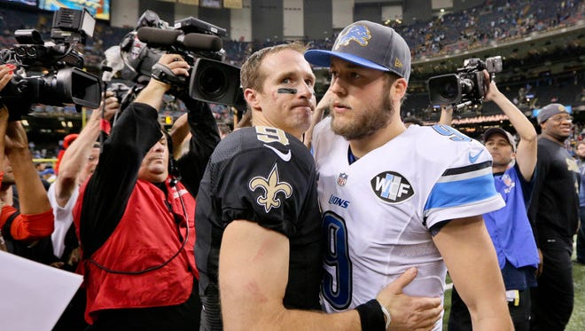 Dec 21, 2015; New Orleans Saints quarterback Drew Brees (9) and Detroit Lions quarterback Matthew Stafford (9) meet following a game at the Mercedes-Benz Superdome. The Lions defeated the Saints 35-27.