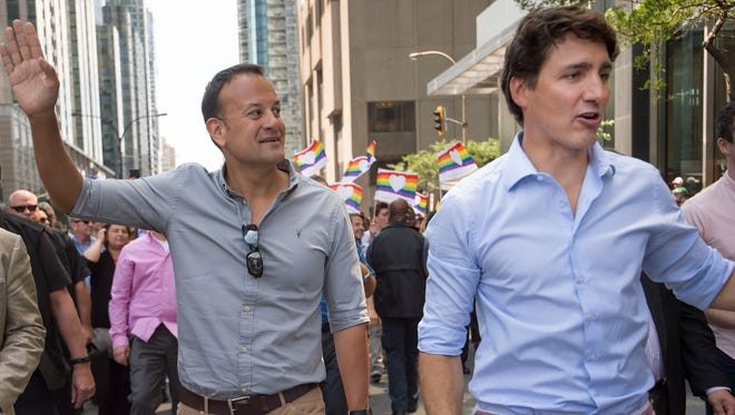 Leo Varadkar, Taoiseach of Ireland left, and Canadian Prime Minister Justin Trudeau walk along Boulevard Rene-Lvesque during the Pride parade in Montreal Quebec, Canada on Aug. 20, 2017.