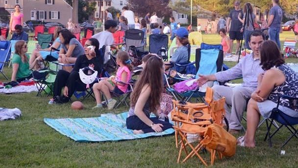 Families stake out spots for the movie in Fanwood's LaGrande Park on Wednesday night, June 24, following the eighth annual Party in the Park.