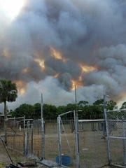 Nikone Thackthay, shared this photo showing the view of a brush fire on 28th Ave SE  Thursday, April 20, 2017.