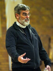 Br. Guy Consolmagno, SJ, spoke of his journey from being a student Our Lady Queen of Martyrs to becoming the director of the Vatican Observatory.