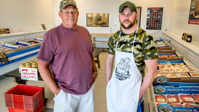 Conor Musselman, right, 28, opened for business June 1 in his new meat market, the former Lennie's Quality Meat Shop, 654 W. Jackson Street, in Morton. Lennie Meyering, left, 61, recently retired and sold the shop to Musselman, an experienced meat cutter and market manager, after 15 years in business.