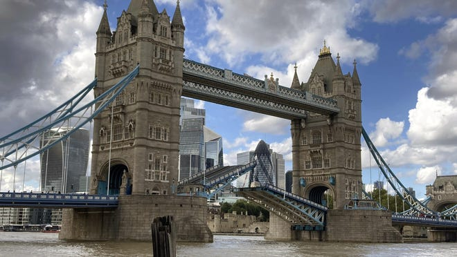 Tower Bridge, which crosses the River Thames, is stuck open leaving traffic in chaos and onlookers stunned as the iconic river crossing remains open Saturday in London.  The historic bridge failed to close Saturday after opening to allow ships to pass underneath.