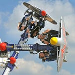 Visitors ride the Air Race Sunday during the final day of the Pensacola Interstate Fair at the Pensacola Interstate Fairgrounds.