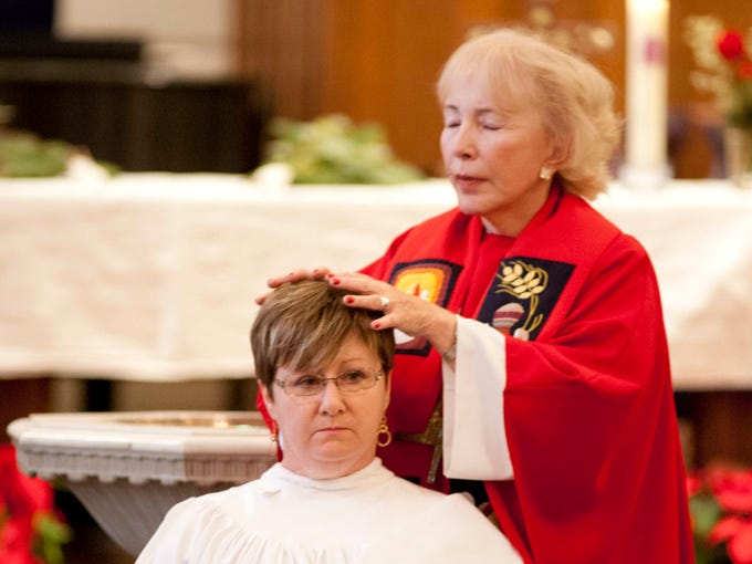 Five Roman Catholic women were ordained (four as deacons and one as a priest) at  Central Presbyterian Church in Louisville by the Association of Roman Catholic Women Priests. Here priest candidate Sue Barnett has hands laid upon her by ordaining Bishop Bridget Mary Meehan, right.   Dec. 08, 2013