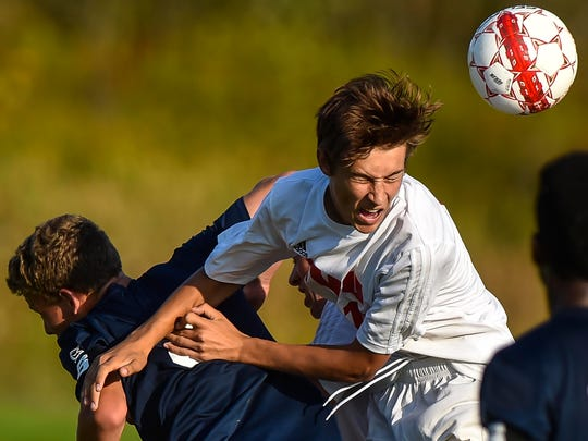 Nicolas Durieux, right, and the Champlain Valley Redhawks should be one of the top contenders in Division I again.