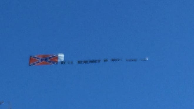 A plane carrying a Confederate flag flew over Tallahassee on Tuesday.