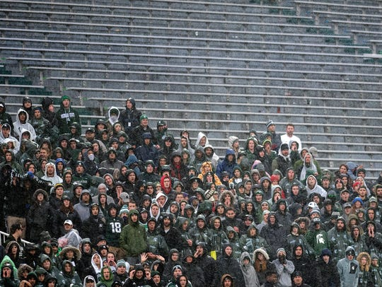 Michigan State fans cheer with plenty of empty seats